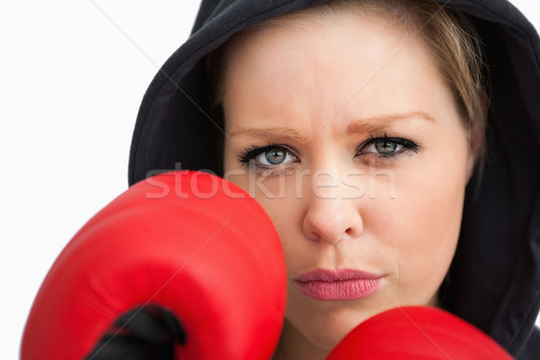 Woman protecting her face with boxing gloves against white background Stock photo © wavebreak_media