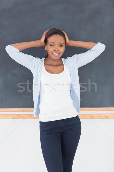 Afroamerikai nő zaklatott iskolatábla osztályterem iskola oktatás Stock fotó © wavebreak_media