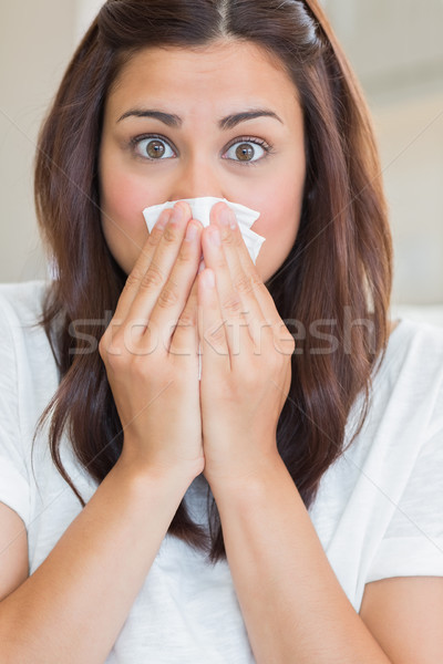 Brunette with runny nose at home Stock photo © wavebreak_media