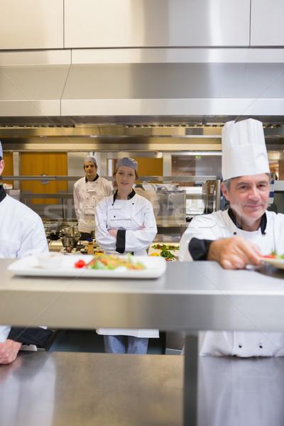 Elfoglalt étterem konyha séfek étel mosoly Stock fotó © wavebreak_media