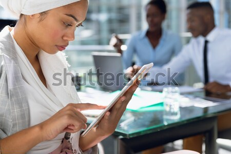 Student in computer room holding tablet pc Stock photo © wavebreak_media