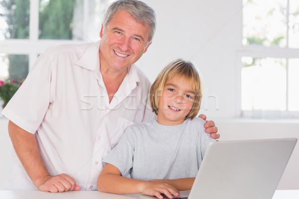 Nagyapa gyermek néz kamera mosoly elöl Stock fotó © wavebreak_media