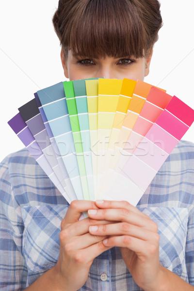 Pretty girl hiding face with colour charts Stock photo © wavebreak_media