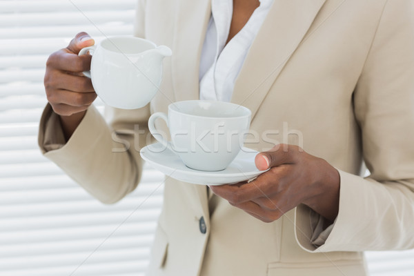 Mid section of elegant businesswoman with tea cup Stock photo © wavebreak_media