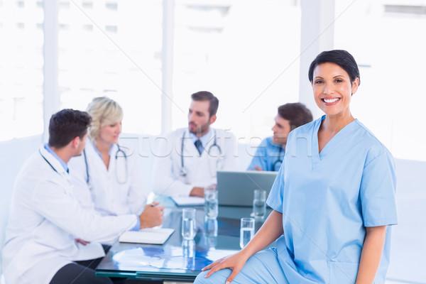 Sorridere femminile chirurgo colleghi riunione ritratto Foto d'archivio © wavebreak_media