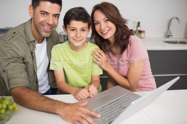 Portrait of a smiling couple with son using laptop Stock photo © wavebreak_media