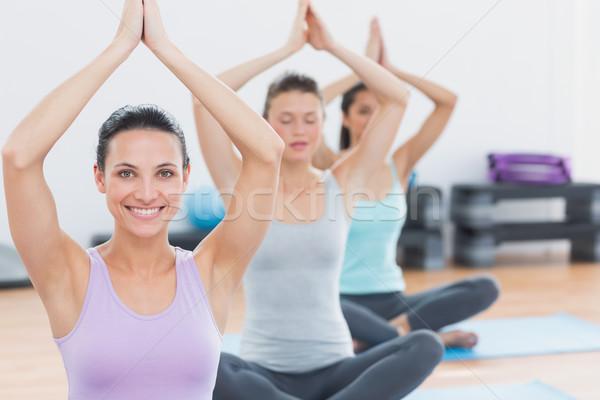 Women with joined hands at fitness studio Stock photo © wavebreak_media