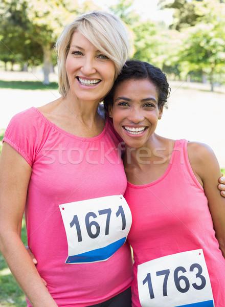 Femmes cancer du sein marathon portrait souriant parc Photo stock © wavebreak_media