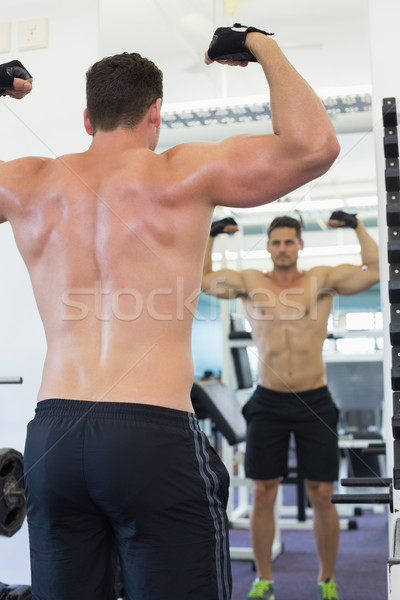Shirtless bodybuilder flexing in front of the mirror Stock photo © wavebreak_media