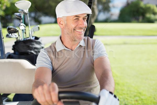 Feliz jogador de golfe condução golfe campo de golfe Foto stock © wavebreak_media