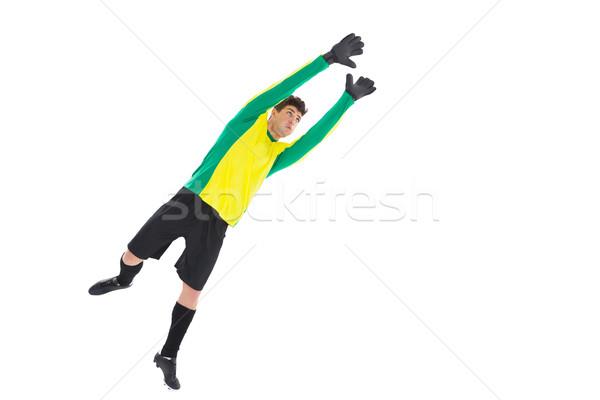 Kapus citromsárga ugrik felfelé fehér futball Stock fotó © wavebreak_media