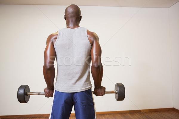Rear view of a muscular man lifting barbell Stock photo © wavebreak_media