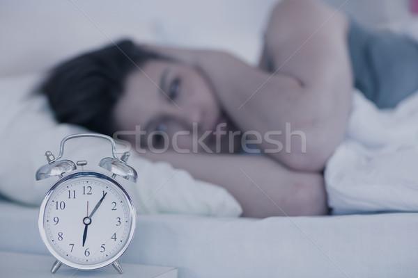 Beautiful brunette sleeping in her bed Stock photo © wavebreak_media