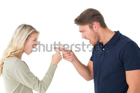 Stock photo: Young couple pointing at each other