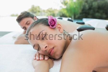 Woman lying on massage table at spa center Stock photo © wavebreak_media