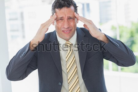 Businessman with severe headache at office Stock photo © wavebreak_media