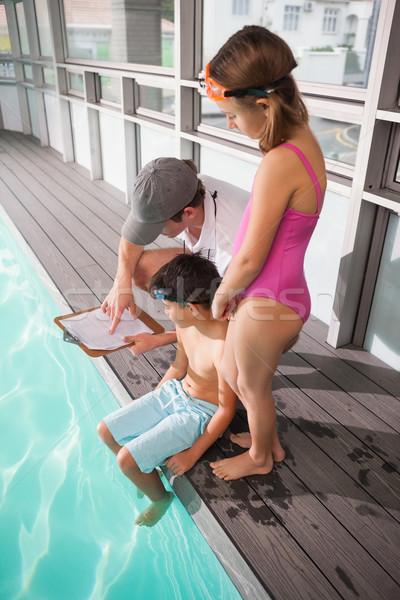 Swimming coach with his students Stock photo © wavebreak_media