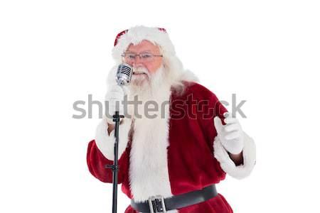 Papai noel cantando natal música homem branco Foto stock © wavebreak_media