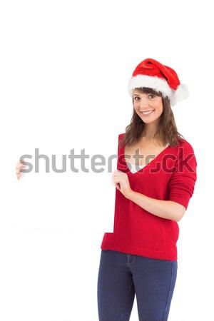 Festive brunette holding a poster Stock photo © wavebreak_media