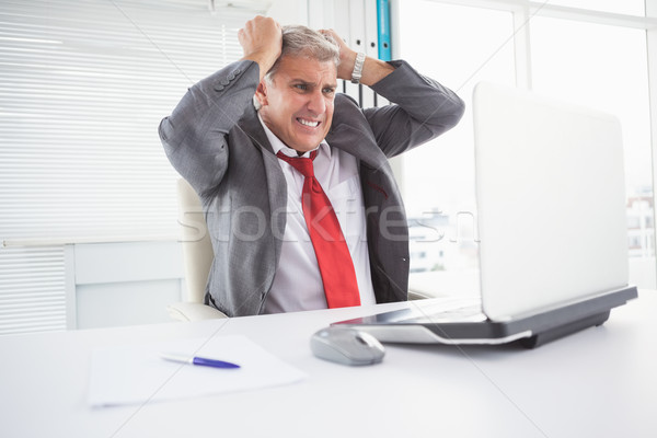 Stressed businessman at his desk Stock photo © wavebreak_media
