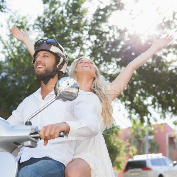 Cute couple riding a scooter Stock photo © wavebreak_media