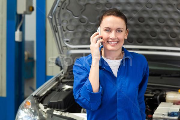 механиком улыбаясь камеры телефон ремонта гаража Сток-фото © wavebreak_media