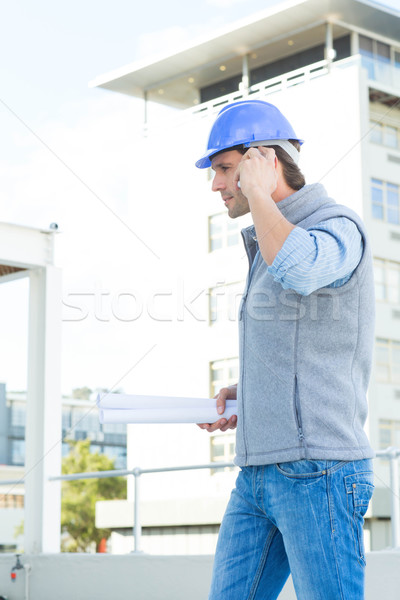 Stock photo: Architect using mobile phone outside building