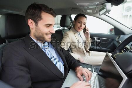 Salesman giving key to a smiling couple Stock photo © wavebreak_media