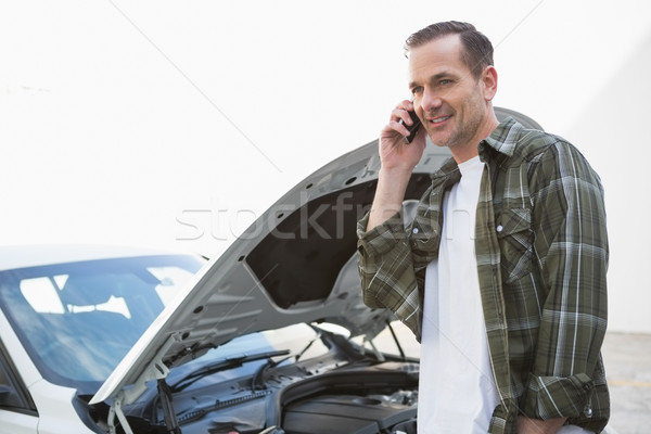 Smiling man calling for assistance after breaking down Stock photo © wavebreak_media