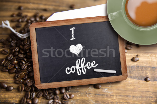 Composite image of green cup of coffee Stock photo © wavebreak_media