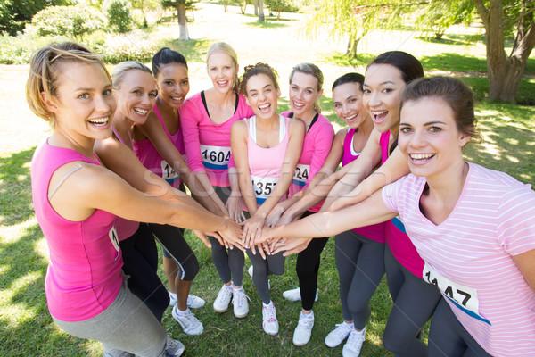 Mosolyog nők fut mellrák tudatosság napos idő Stock fotó © wavebreak_media