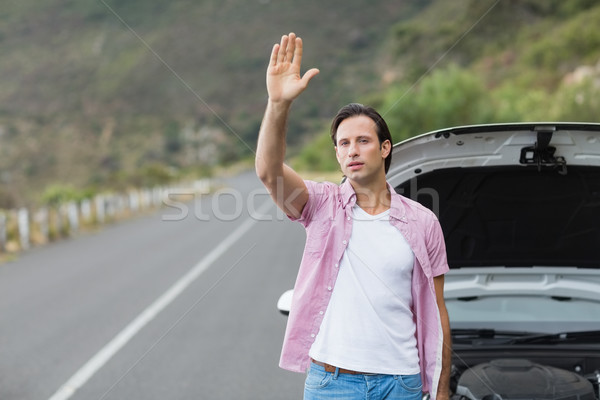 Man waving after a breakdown  Stock photo © wavebreak_media