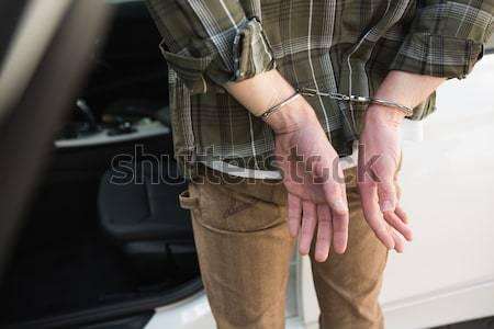 Uomo manette piedi auto legge giustizia Foto d'archivio © wavebreak_media