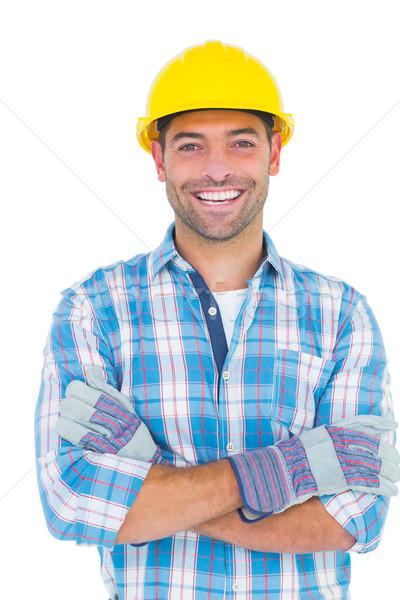 Retrato sonriendo manual trabajador los brazos cruzados blanco Foto stock © wavebreak_media