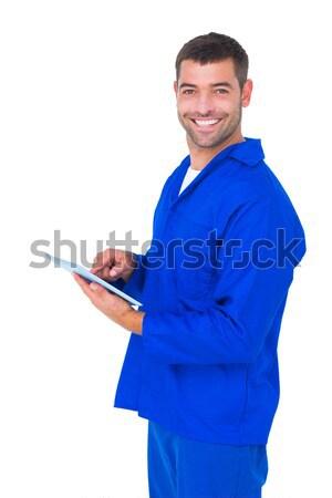 Happy male mechanic using tablet computer Stock photo © wavebreak_media