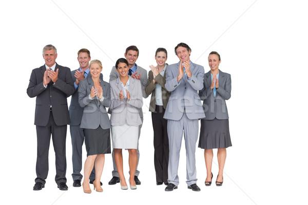 Smiling business team applauding at camera Stock photo © wavebreak_media