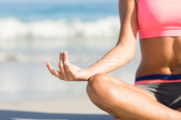 Close up view of fit woman doing yoga beside the sea   Stock photo © wavebreak_media