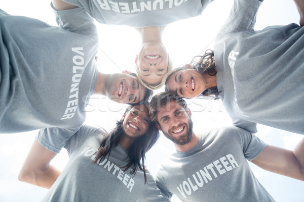 Boldog önkéntesek alulról fotózva portré férfi segítség Stock fotó © wavebreak_media