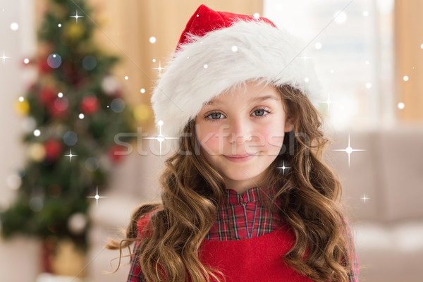 Composite image of festive little girl smiling at camera  Stock photo © wavebreak_media