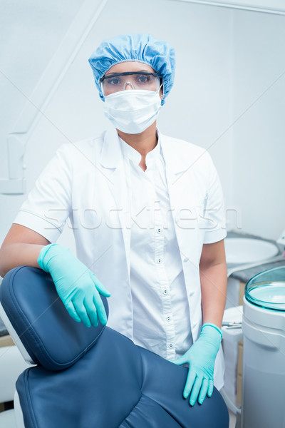 Stock photo: Dentist wearing surgical mask and safety glasses