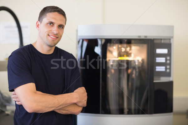 Engineering student smiling beside 3d printer Stock photo © wavebreak_media