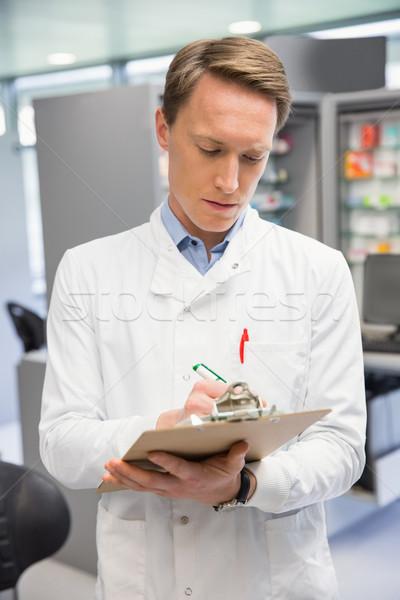 Yakışıklı eczacı yazı hastane eczane Stok fotoğraf © wavebreak_media