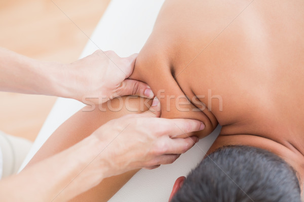 Physiotherapist doing shoulder massage to her patient Stock photo © wavebreak_media