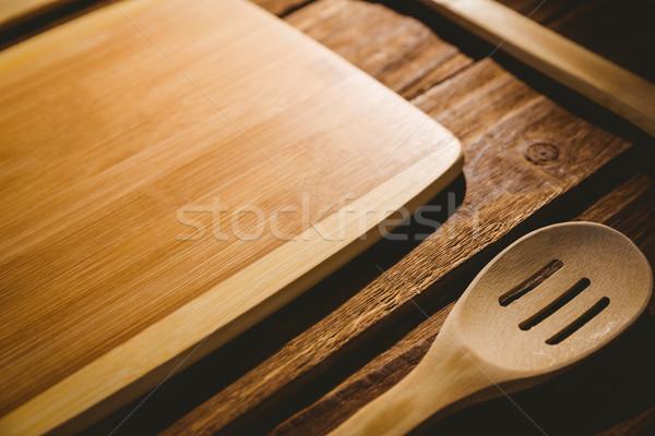 Chopping board with wooden utensils Stock photo © wavebreak_media