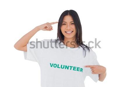 Composite image of smiling woman pointing to her volunteer tshir Stock photo © wavebreak_media