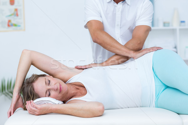 Doctor massaging his patient back Stock photo © wavebreak_media