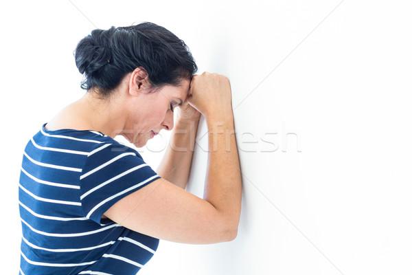 Triste femme mur blanche Homme Photo stock © wavebreak_media