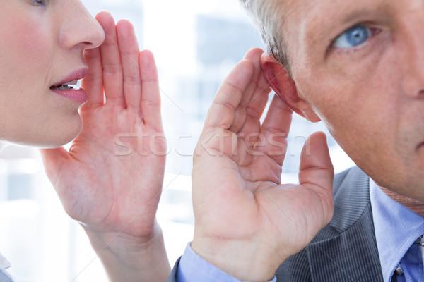 Business colleagues whispering Stock photo © wavebreak_media
