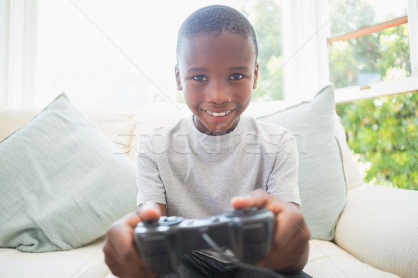 Little boy playing video games  Stock photo © wavebreak_media