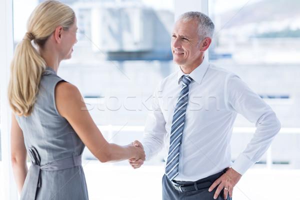 Twee glimlachend zakenlieden handen schudden kantoor handen Stockfoto © wavebreak_media